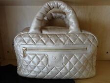 89f61ded1400 Chanel Coco Cocoon Bowler Bag Handbag metallic Vanilla leather Goldtone NEW