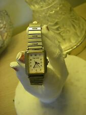 * Vintage Oleg Cassini women's dainty silver tone watch O.C. stamped new battery