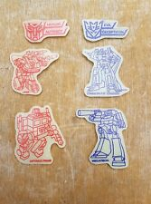 Original Vintage années 1980 TRANSFORMERS G1 Glow In The Dark Wall Plaques/insignes X 6