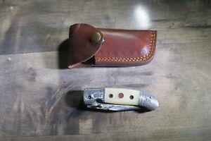 Damascus folding blade knife w/ white bone handle, Damascus  & leather case