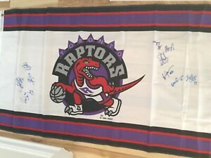 Toronto Raptors basketball Signed by Vince Carter and the team flag with COA