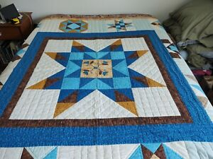 """Handmade 84""""X 74"""" Quilt with two pillow shams. Not sure of age."""