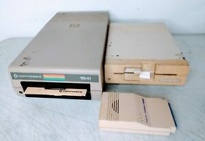 COMMODORE 1541 & 1541ii FLOPPY DISC DRIVES & COMMODORE 1670 MODEM 1200