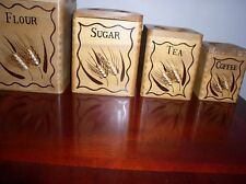 SET OF 4 VINTAGE WOODEN CANISTERS MADE IN JAPAN