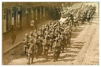 Antique WW1 military RPPC postcard German soldiers marching down a street