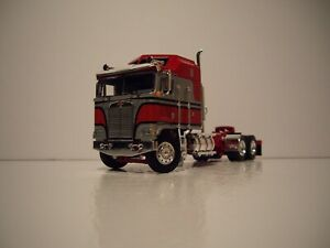 DCP FIRST GEAR 1/64 RED AND SILVER KENWORTH K100 COE WITH AERODYNE SLEEPER CAB