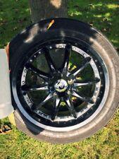 Enkei performance black rims and tires