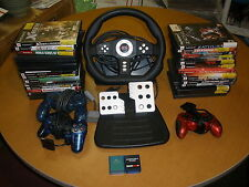 PS2 lot of 31 games, 2 memory cards, 3 controllers, steering wheel and pedal