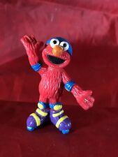 Sesame Street Henson Elmo Figure On Roller Skates cake topper
