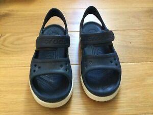 Crocs beach sandals.  Size 3
