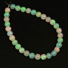 4.8mm Fine Ethiopian Crystal Opal Plain Round Beads 5 inch strand