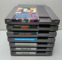 7 NES Game Lot Tetris 2, Jaws, Jackal, Duck Hunt, Golgo 13, Nintendo games! A9