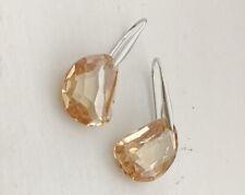 Made from Swarovski crystal drop in Ocean-cut Amber Galet Pierced Earring