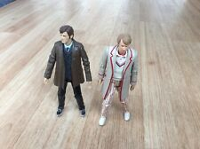2 Doctor who action figures .