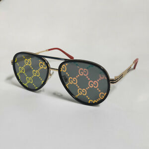 GUCCI GG0982S Gold-Red Frame Sunglasses Pink lens with GG Motif