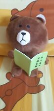 Brown bear reading a book pushie