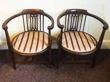 A MATCHING PAIR OF ELBOW CHAIRS, Edwardian, Mahogany with Satinwood Inlay