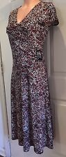 DONNA TORAN, Size Small, 100% Polyester Dress in an Animal-like Print.