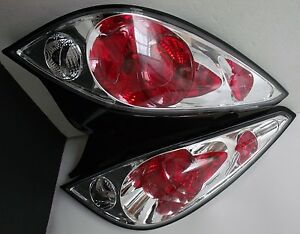 05-10 PONTIAC SET OF TWO.R-L TAIL LIGHTS.CHROME & CLEAR LENS.COUPE ONLY.