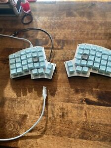 Iris split mechanical keyboard with switches and keycaps  ortholinear