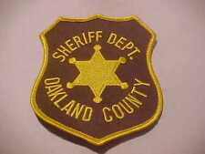 OAKLAND COUNTY MICHIGAN POLICE PATCH  BROWN/GOLD SHOULDER SIZE UNUSED