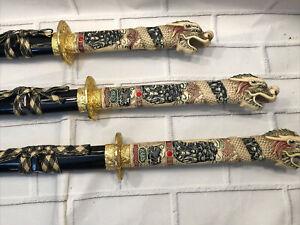 Samurai/katana sword Pair Of Three With Dragon Design Black. With Decor Stand.