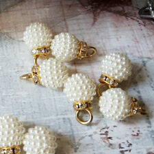 Pearl cluster buttons with crystal shank.
