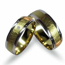 Ein paar Trauringe- Eheringe, Weiss- und Gelbgold 585, mit Diamanten