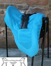 Turquoise Dressage Saddle cover with girth pockets