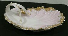 Antique porcelain vanity/leaf bowl with handle. Lite pink glaze with gold edges