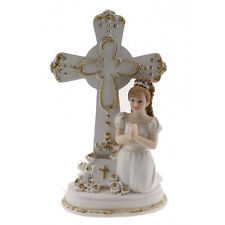 Communion Girl Praying Next to a Cross Dressed in White with Gold Acents