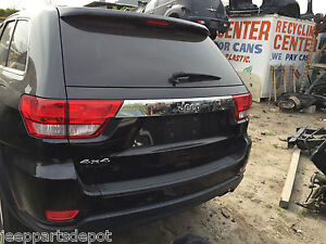 2012 JEEP GRAND CHEROKEE  BUMPER COVER WITH LIGHTS AND METAL REINFORCEMENT OEM
