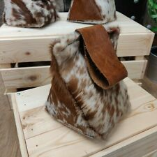 Cow hide and leather door stops in brown speckled pattern
