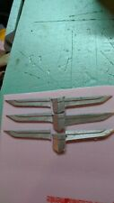 CADILLAC 1959 wings and badges your bidding on all three sets