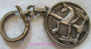 IN13584 - PORTE-CLES ARGENS, L. 9003, rondache argentée 35 mm