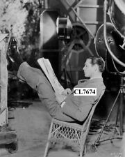 Clark Gable Reading a Newspaper on the Movie Set Photo