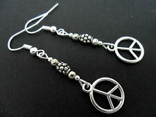 A PAIR OF  TIBETAN SILVER DANGLY   PEACE SIGN DANGLY EARRINGS. NEW.