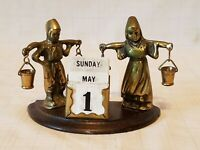 Metal Figural Dutch People Carrying Pails of Water Desktop Month Day Calendar