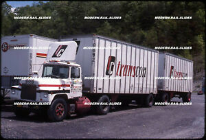Original slide: Semi-truck tractor trailer: TC Transcon 620489 MACK with tandem