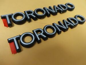 New GM OEM 1986 - 1989 Oldsmobile Toronado door nameplates emblems scripts NOS