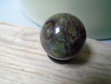 Small Dragons Blood sphere from Australia, 30 mm, 49 grms + hematite ring stand