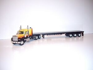 DCP FIRST GEAR 1/64 ORANGE&BLACK MACK SUPER-LINER W/TSLEEPER&TRI-AXLE FLATBED