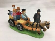 LOT OF 2 CHRISTMAS FIGURINES - CHILDREN ON HORSE-DRAWN HAY WAGON, MAN WITH DOG