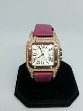 ladies yaki gold tone watch with a crystal set case,gold hands,pink strap.#b2.