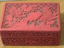 Cinnabar box with beautiful hand carved lid