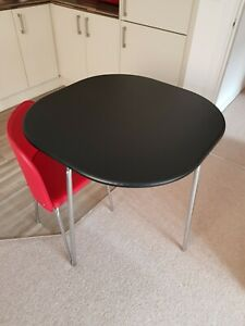 Red & black space saving dining table and 4 chairs. Tuck away stow away
