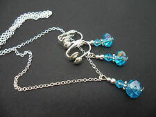 A SILVER PLATED BLUE AQUA CRYSTAL  NECKLACE AND CLIP ON EARRING SET. NEW.