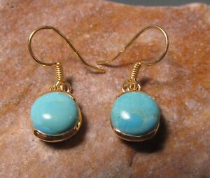 Sterling silver with 18k gold plate 9mm cabochon turquoise earrings.