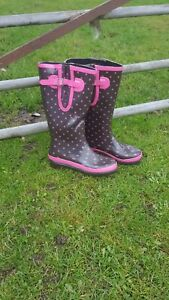Black and pink rubber wellies