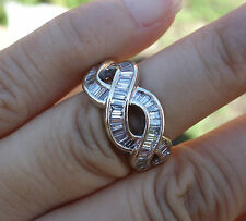 ring 14k Wg sz 5.25, 10.3mm 1ct H/Vs-Si1 Baguette diamond twisted right hand